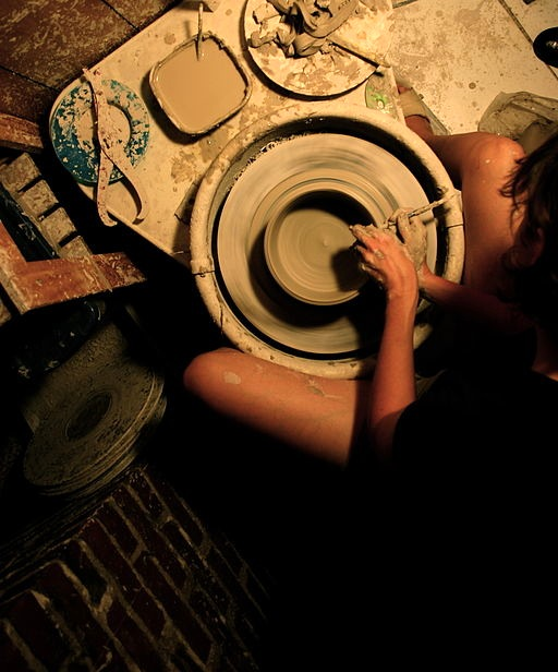 A potter creates a bowl on her electric-powered pottery wheel. (Location: Memphis, Tennesse. Potter: Melissa Bridgman of Bridgman Pottery). By Gary Bridgman (Own work) via Wikimedia Commons