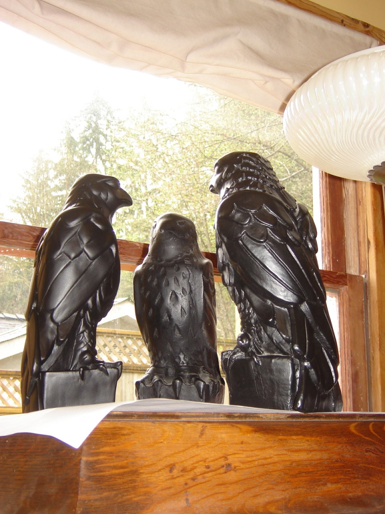Different renditions of the Maltese Falcon chatting atop our Victrola
