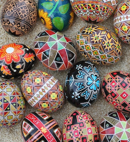 A mix of traditional Ukrainian, diasporan and original pysanky Easter eggs. Ukrainian pysanky, made with a beeswax resist method, depict fruit and flowers, geometric, animal, Christian, and solar motifs. Colors are also symbolic. Photo by Ukrainian Easter Eggs, Lubap, creator Luba Petrusha via Wikimedia Commons